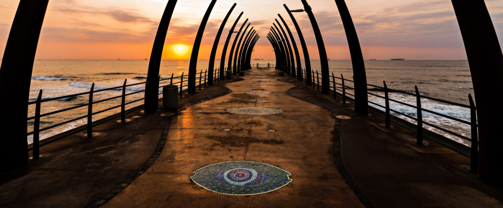 View of the Indian Ocean through the Millenium Pier in Umhlanga Rocks at Sunrise